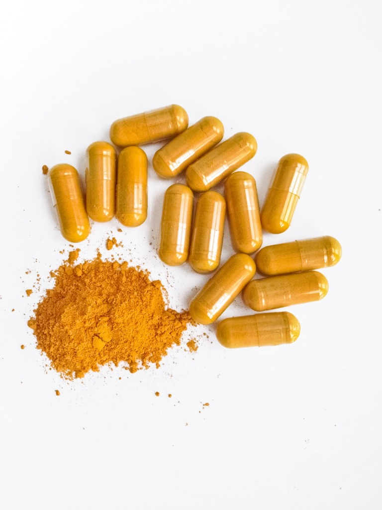Clear capsules with orange powder inside